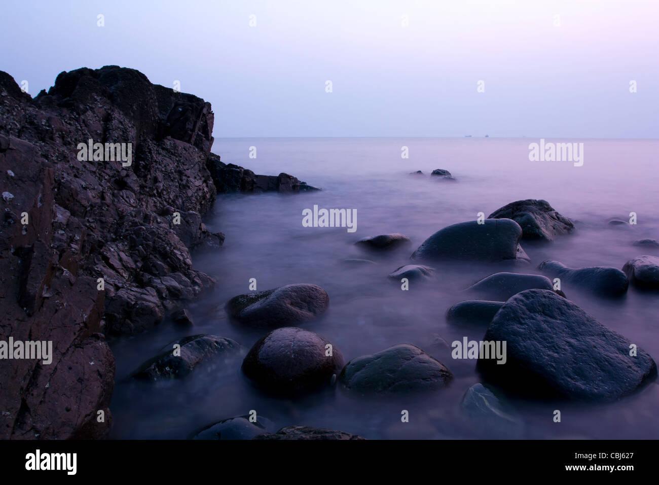 Stone sea fog,Sea, mist,beach,sunrise,Stone island, the South China  Sea, Qingdao,ZhuChadao,Shaped stone,Slow  gate,B,Cobbleston - Stock Image