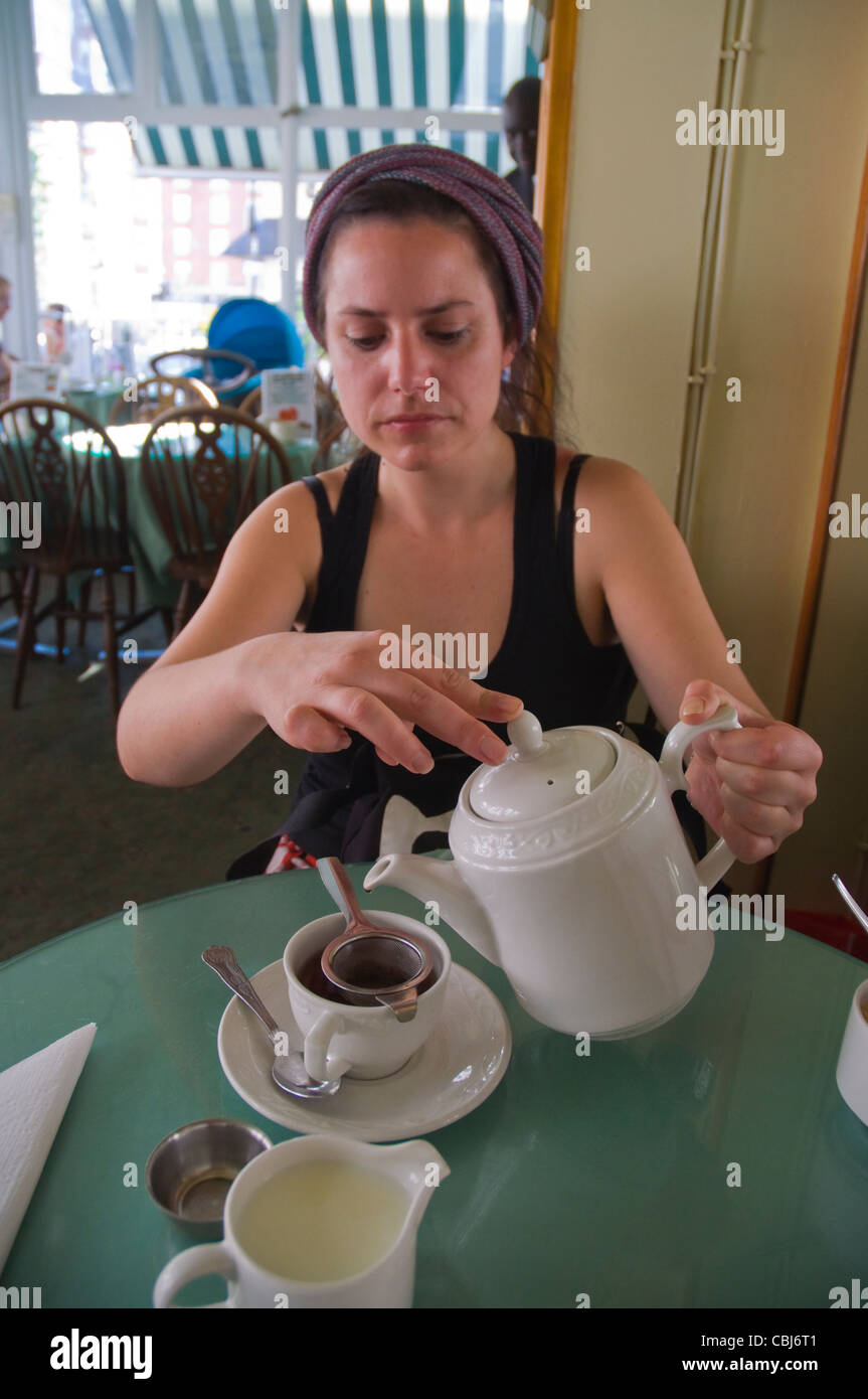 Tea drinking Muffinman tea room Kensington district London England UK Europe - Stock Image