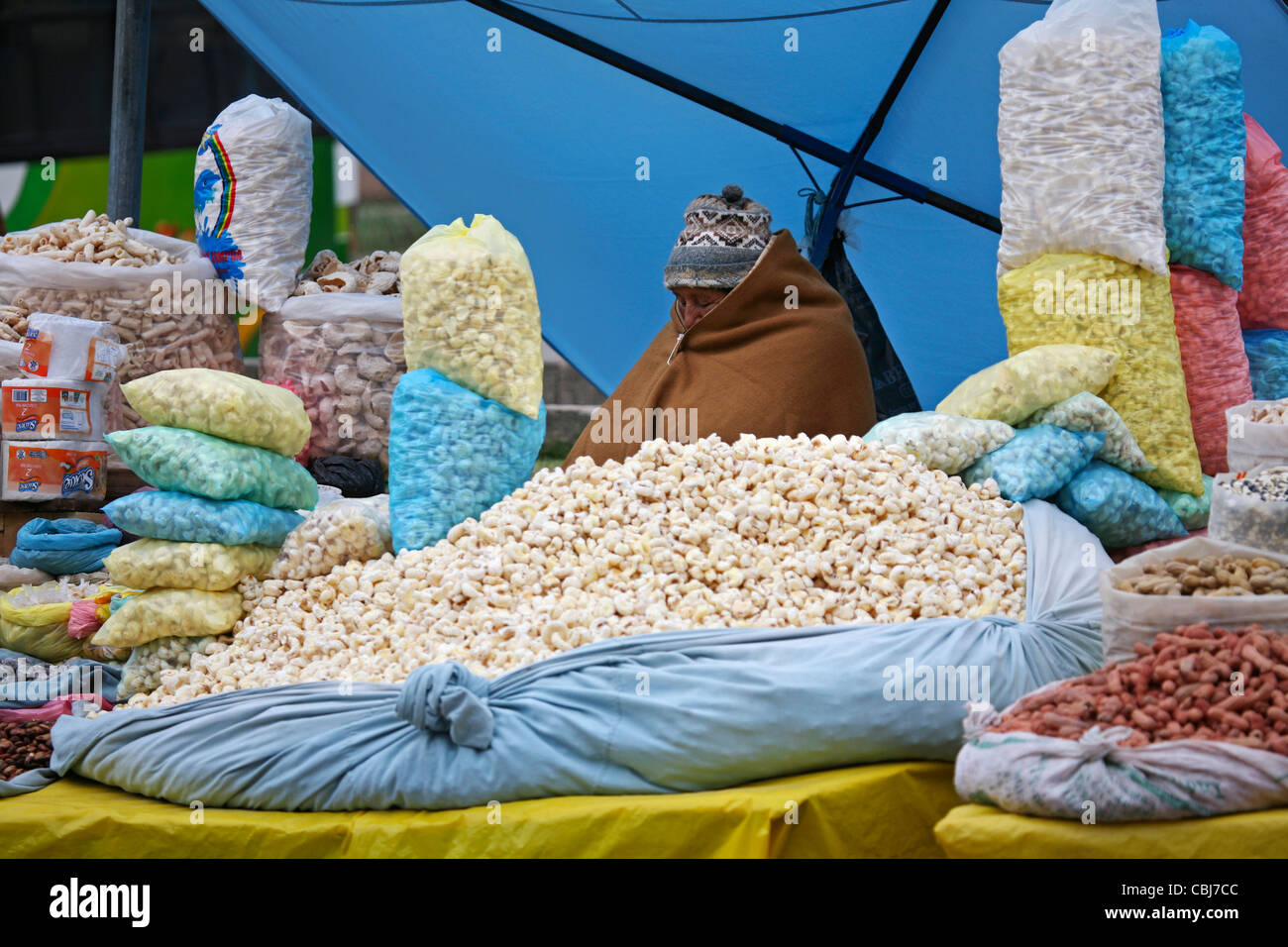 Bags with popcorn on sale at market in Copacabana, Bolivia - Stock Image