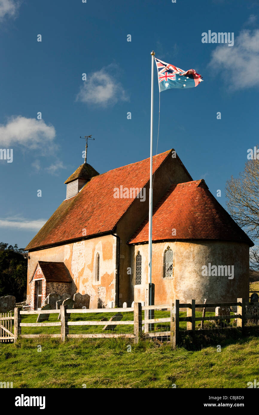 Church of  St Mary The Virgin, Upwaltham, West Sussex on the South Downs with patchwork flag commemorating World Stock Photo