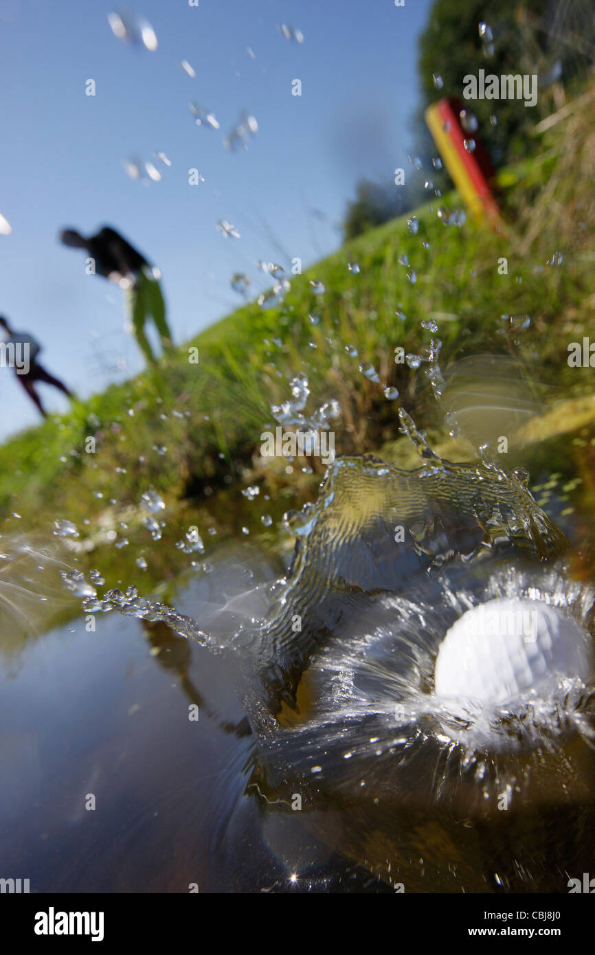 Two men playing golf, Prien am Chiemsee, Bavaria, Germany - Stock Image
