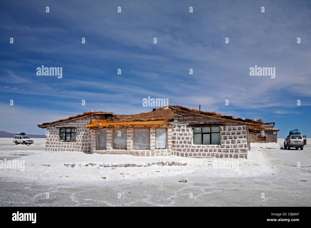 Salt hotel for tourists in the middle of the salt flat Salar de Uyuni, Altiplano in Bolivia - Stock Image