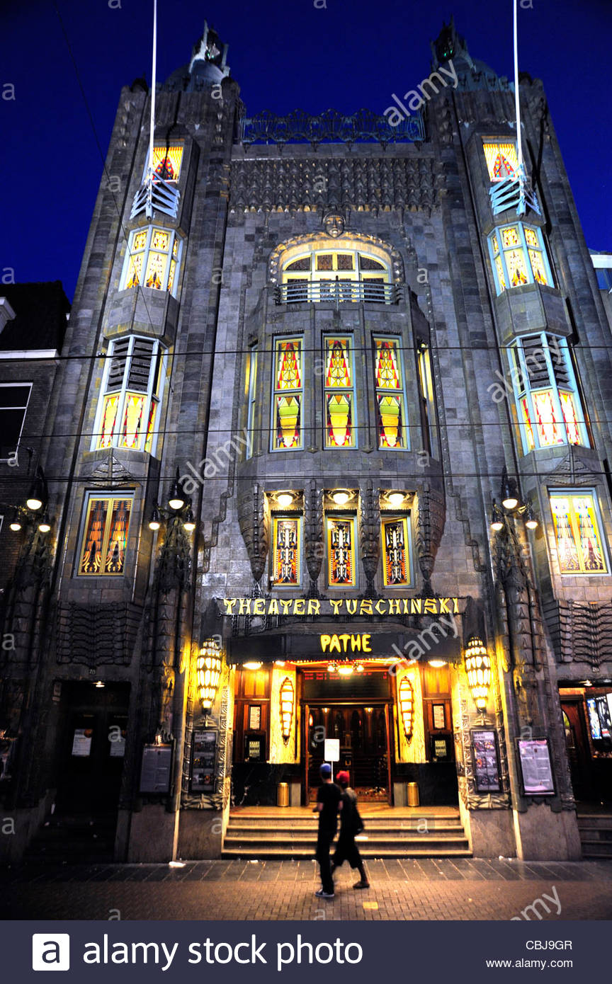 Illuminated Tuschinski Theater Pathe Cinemas Art deco cinema entrance at Reguliersbreestraat Amsterdam the Netherlands - Stock Image