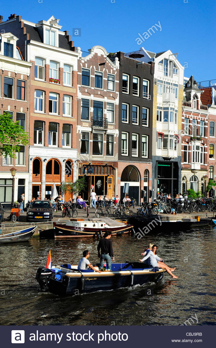 Residential houses and boat on the Prinsengracht canal, Amsterdam, the Netherlands, Europe - Stock Image