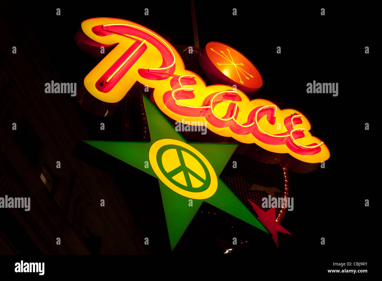 Neon peace sign lit up during Christmas season-Victoria, British Columbia, Canada. - Stock Image