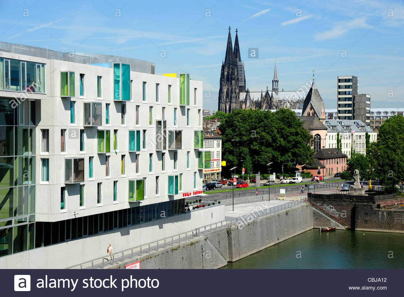 Modern building at the Rheinauhafen inland port in front of Cologne cathedral Cologne Rhineland NRW North Rhine - Stock Image