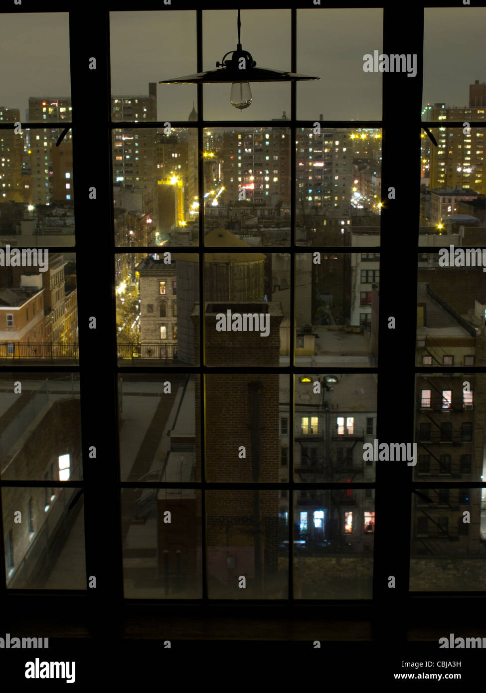12th floor window at night overlooking NYC York City, New York, USA - Stock Image