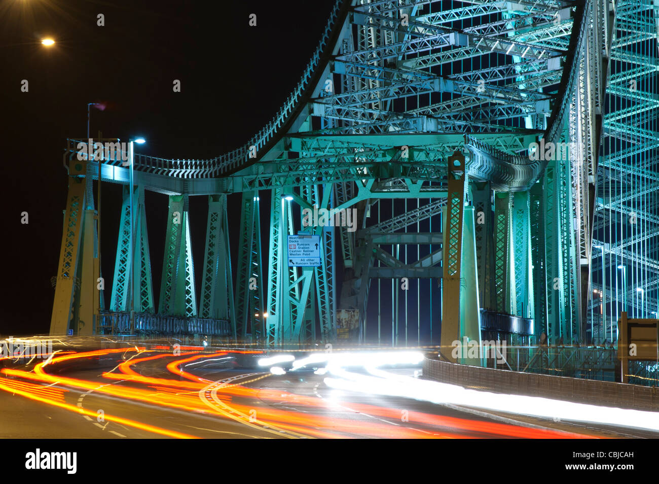 Widnes-Runcorn Silver Jubilee Bridge, photographed at night with long exposure to produce light-trails - Stock Image