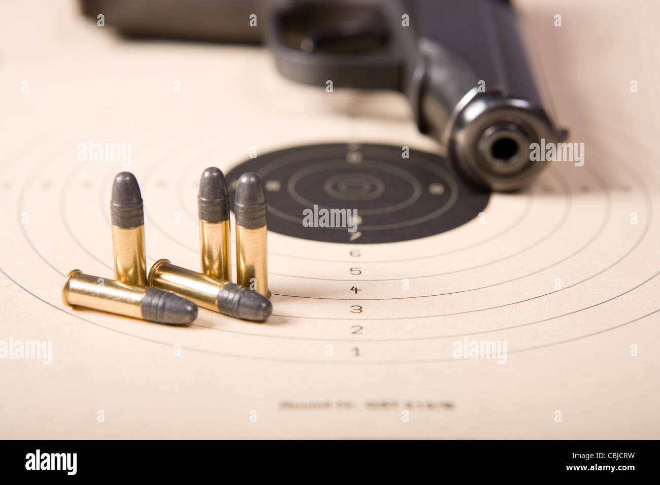 Target bullets and pistol Stock Photo