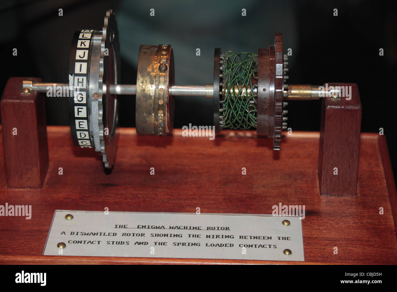 An Enigma machine rotor on display showing the internal ...