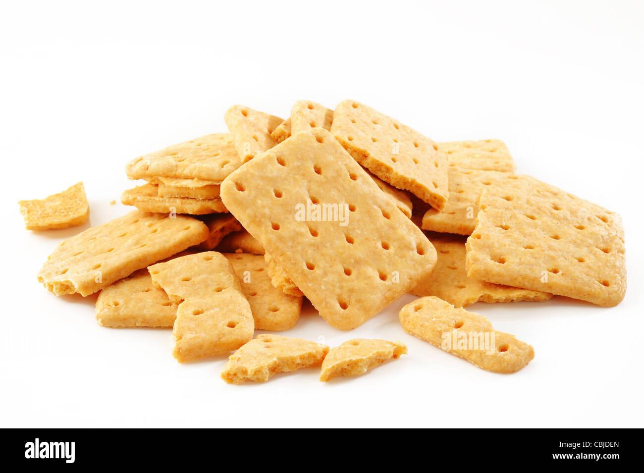 broken cracker on white background - Stock Image
