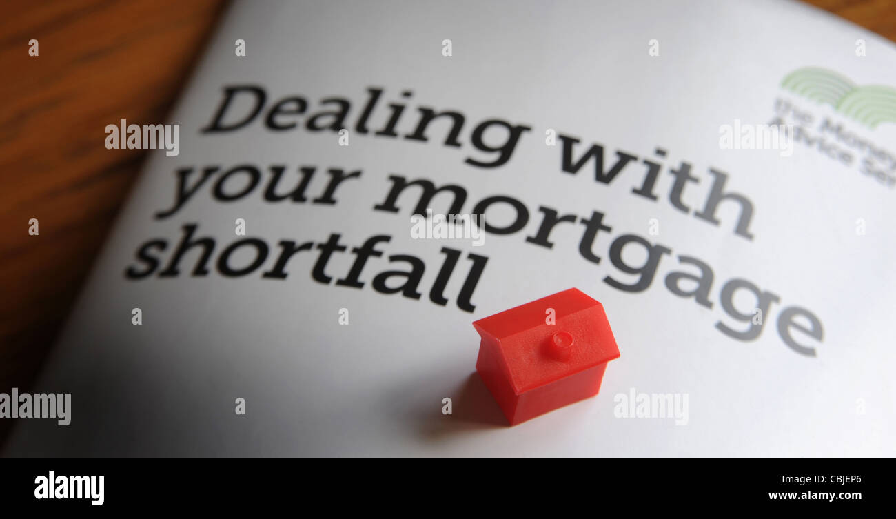 DEALING WITH YOUR MORTGAGE SHORTFALL INFO LEAFLET WITH MODEL HOUSE RE ENDOWMENT MORTGAGE SHORTFALL MORTGAGES NEGATIVE - Stock Image