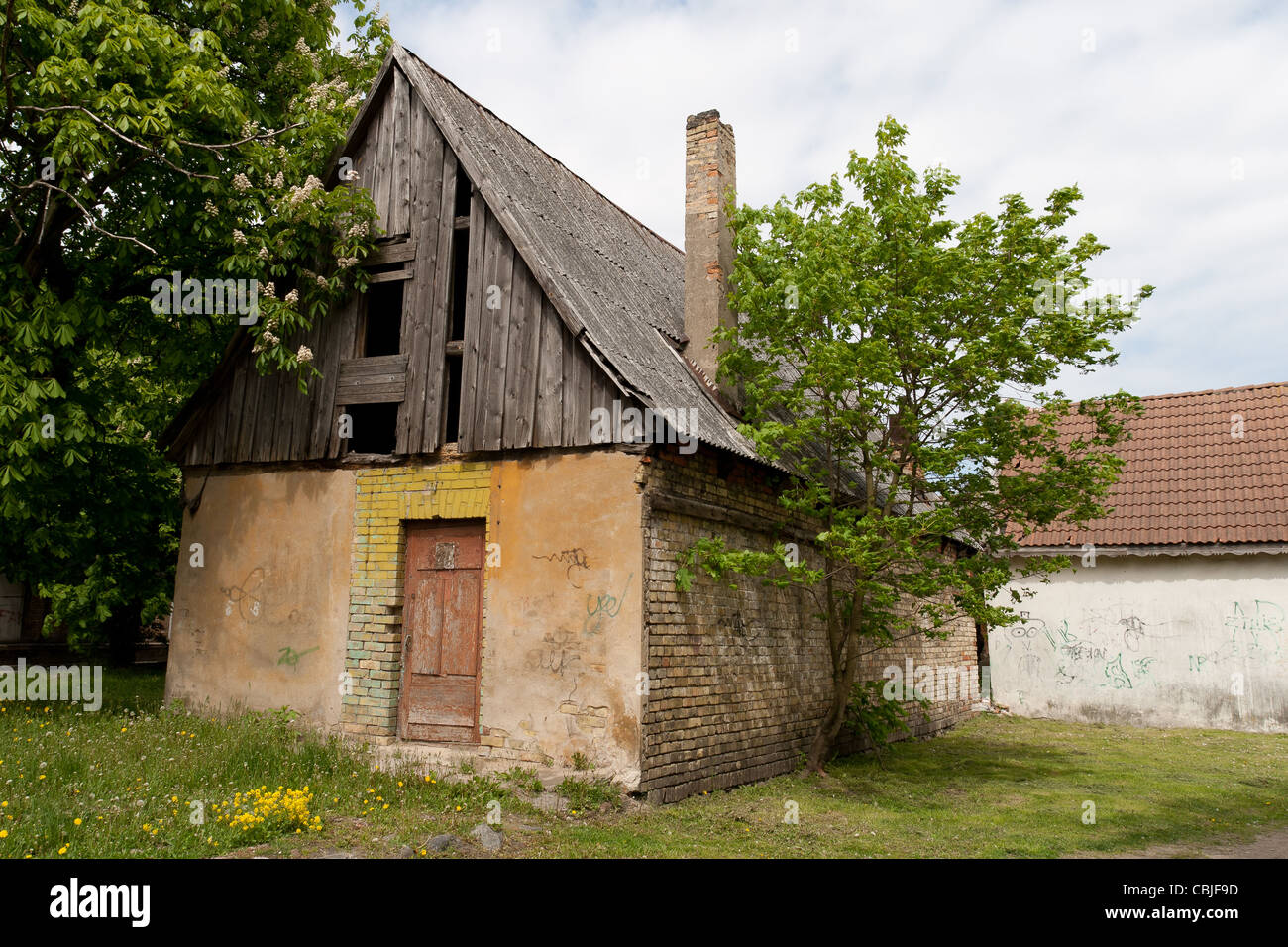 A abandoned house with breaked roof side - Stock Image