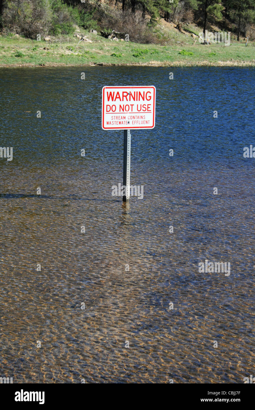warning sign on water for wastewater effluent - Stock Image
