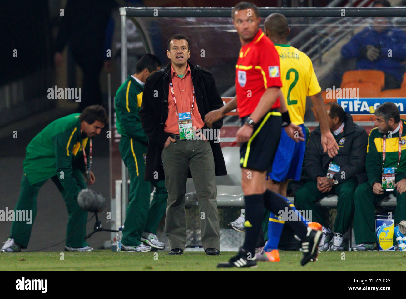 Brazil head coach Dunga directs his team during a 2010 FIFA World Cup match against Côte d'Ivoire at Soccer - Stock Image