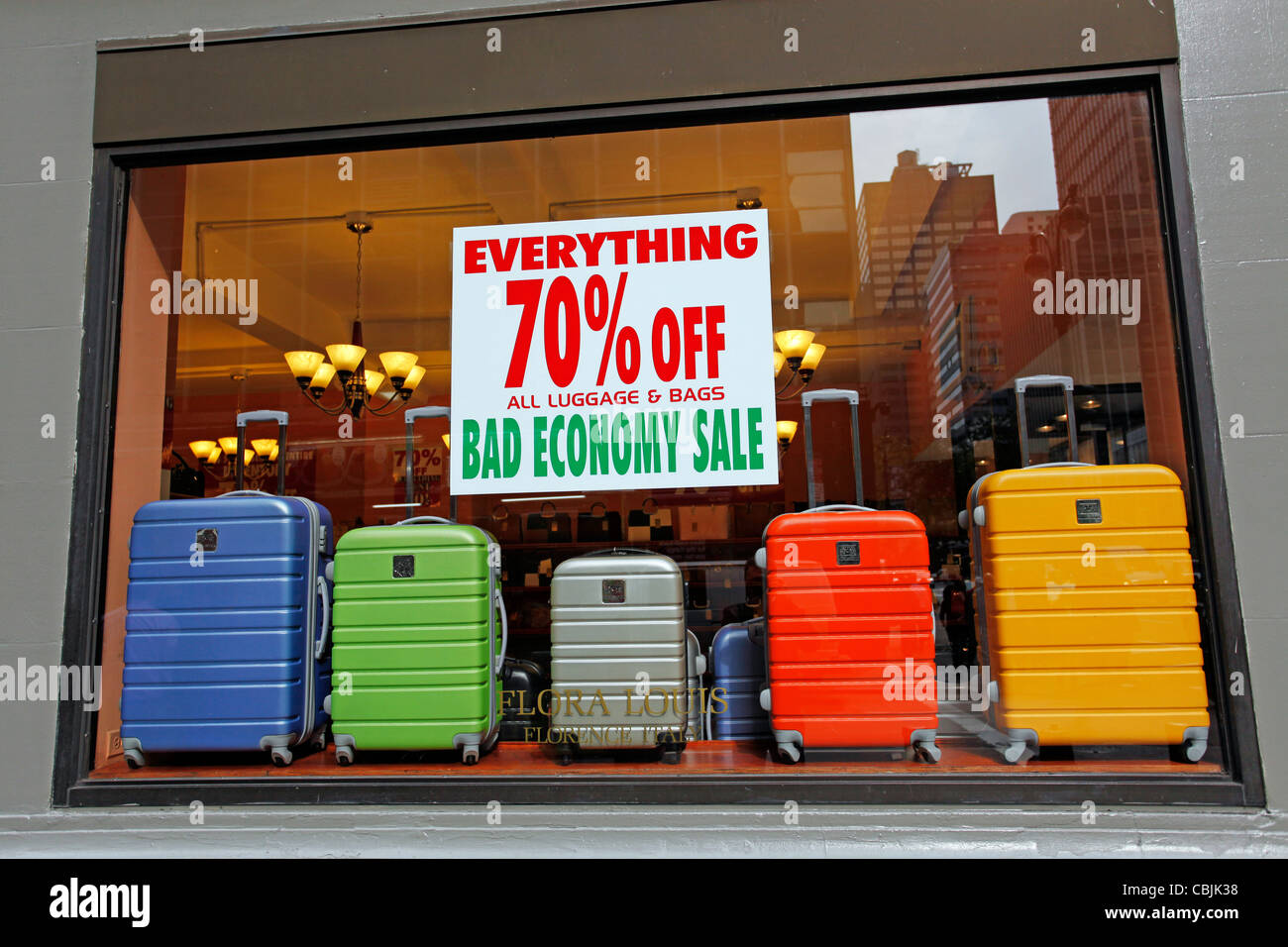 Bad Economy sale sign with 70% off in a luggage and suitcase shop, as a result of slump and economic recession in - Stock Image