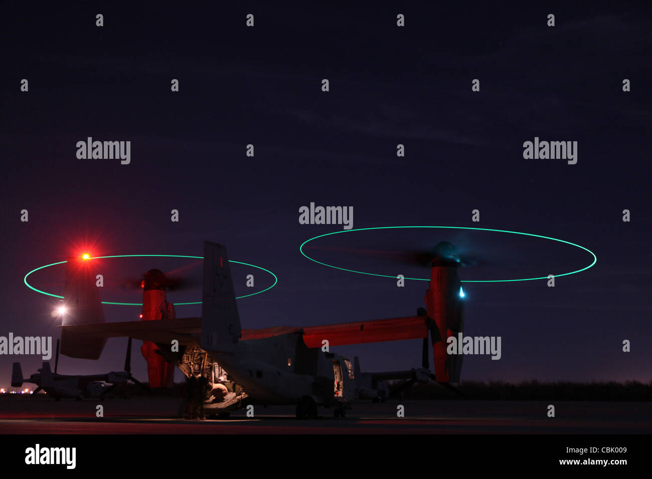 Marine Aviation Weapons and Tactics Squadron One MV-22 Osprey in night time exposure - Stock Image