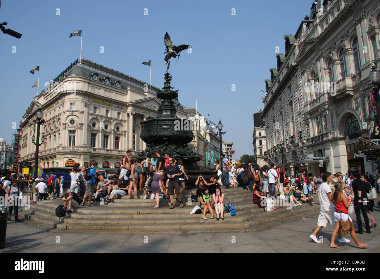 Piccadilly Circus looking northeast at the Shaftesbury memorial fountain and statue of an archer (Anteros); crowded - Stock Image