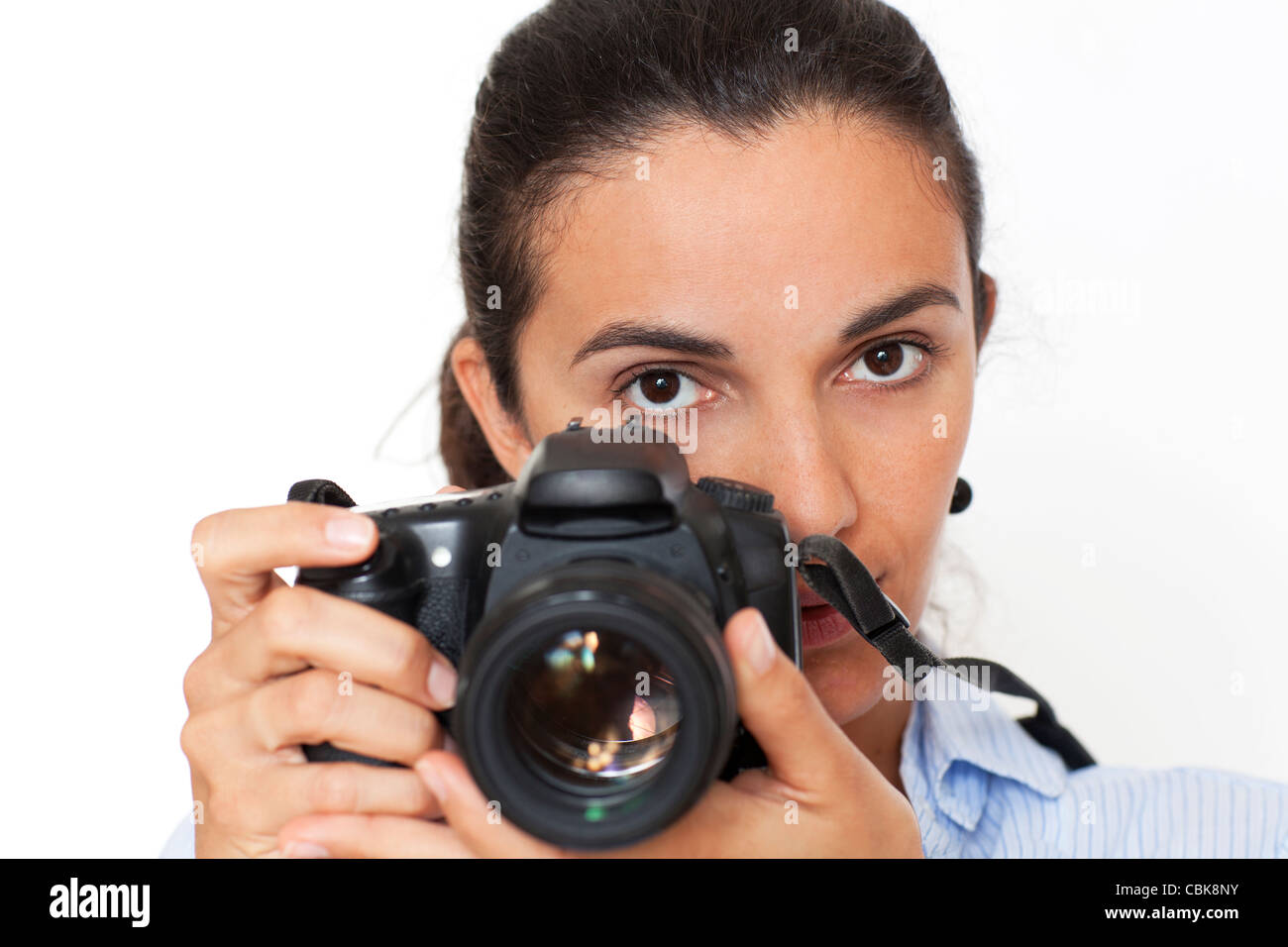 woman takes picture with photocamera - Stock Image