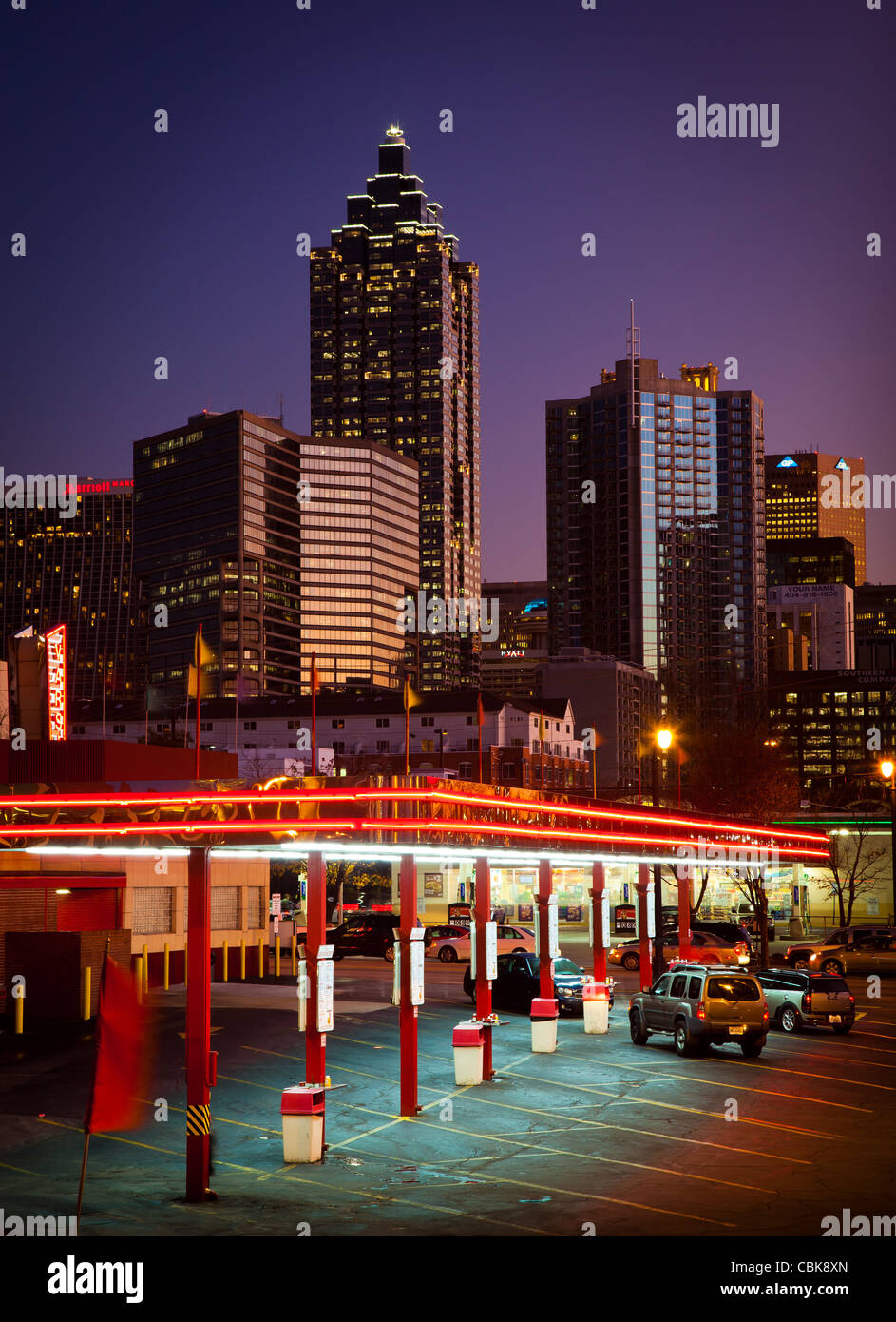 Midtown Atlanta buildings at dusk with a drive-in fast food restaurant in the foreground - Stock Image