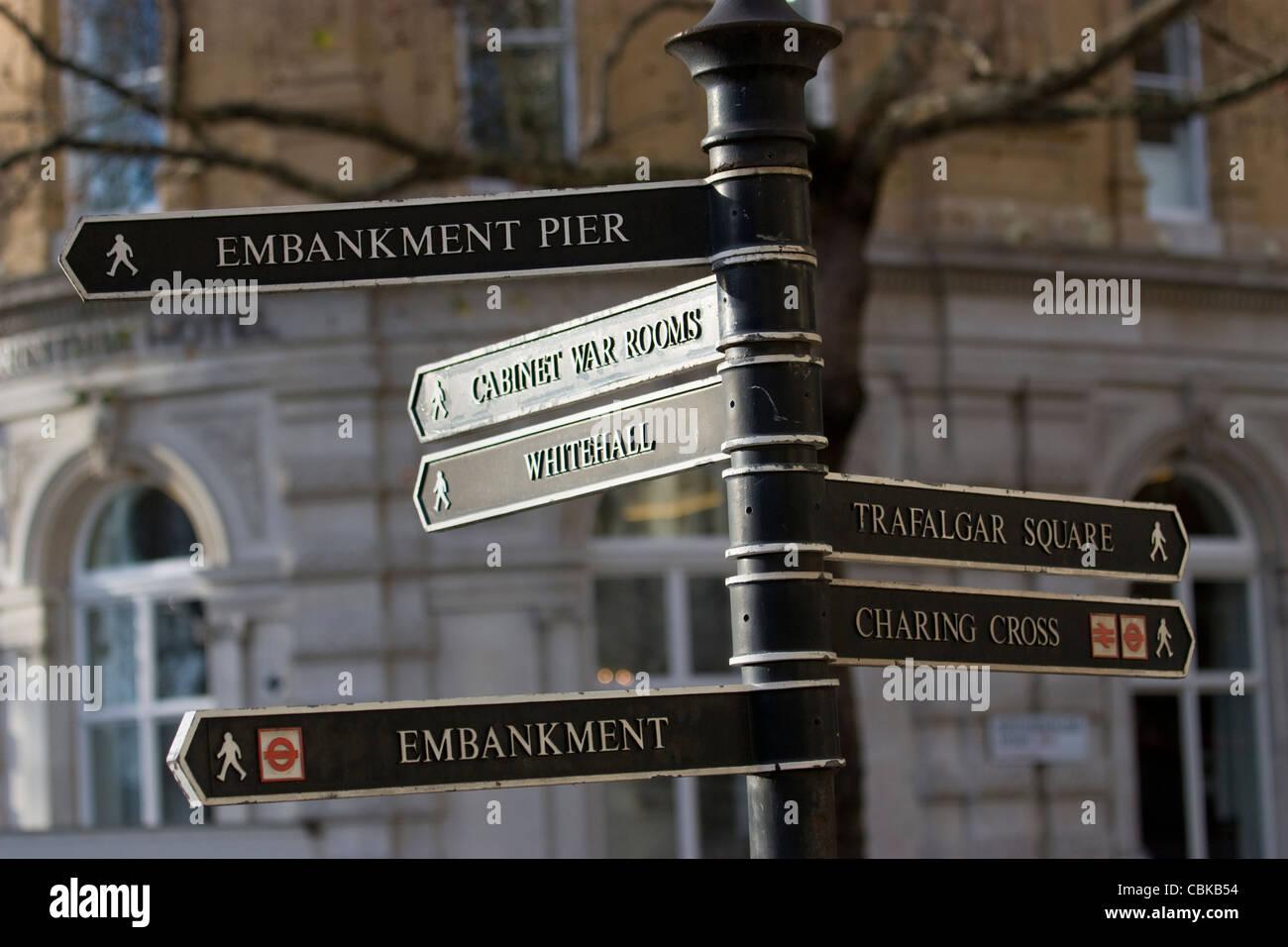 London direction sign, for embankment pier, cabinet war rooms, whitehall, embankment, trafalgar square, Charing - Stock Image