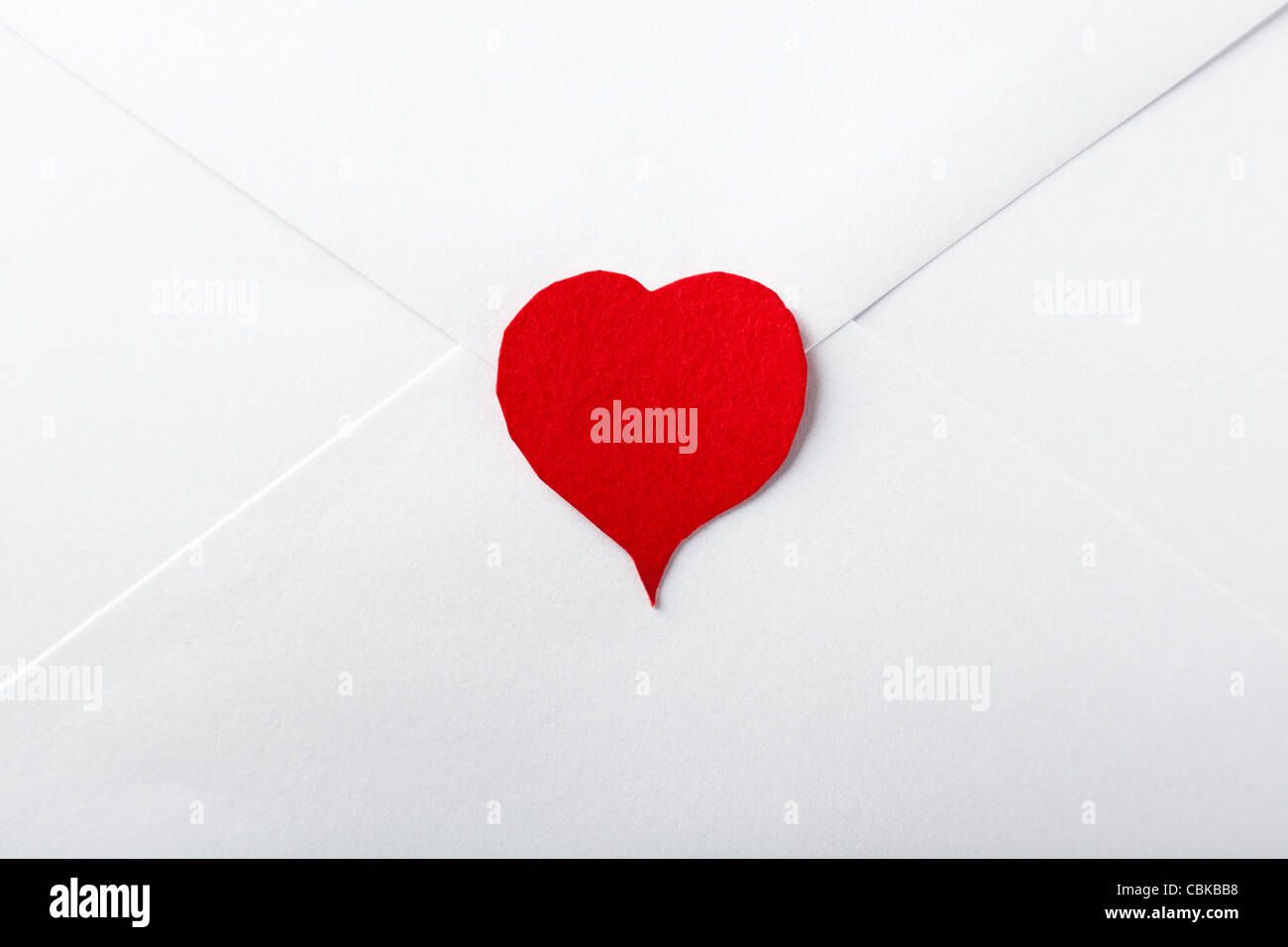 Red Paper Heart on White Envelope - Stock Image
