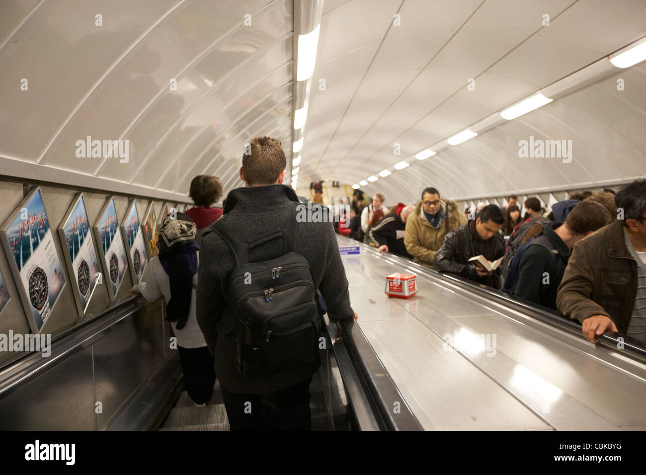 passengers and commuters on the escalator at a london underground tube station england united kingdom uk - Stock Image
