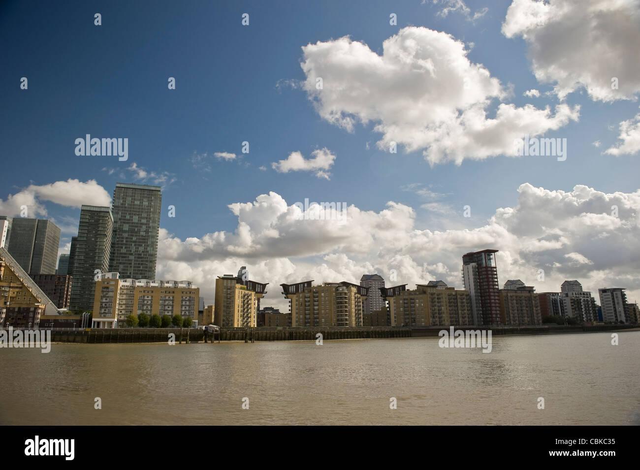 Riverside residential tower blocks in Docklands, London, UK - Stock Image