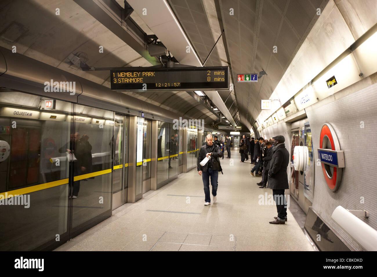 passengers waiting at waterloo london underground train station for train to wembley england united kingdom uk - Stock Image