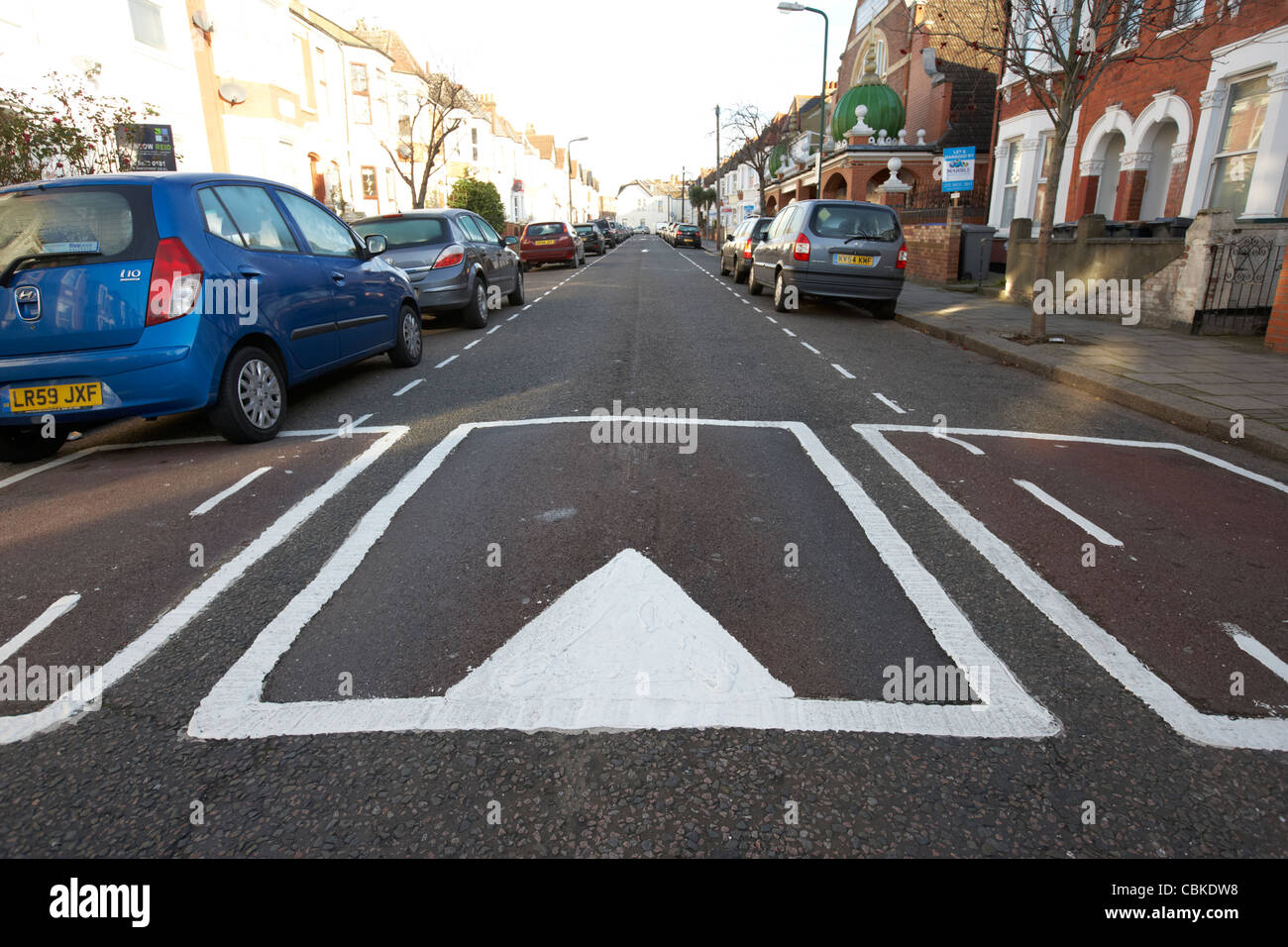 traffic calming measures sleeping policemen speed bumps in a residential street north london england united kingdom - Stock Image