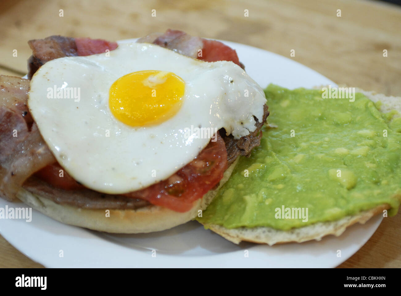 Fast Food. Typical Chilean sandwich made by beef, tomato, bacon, eggs, avocado. Castro, Chiloe Island, Lake's - Stock Image