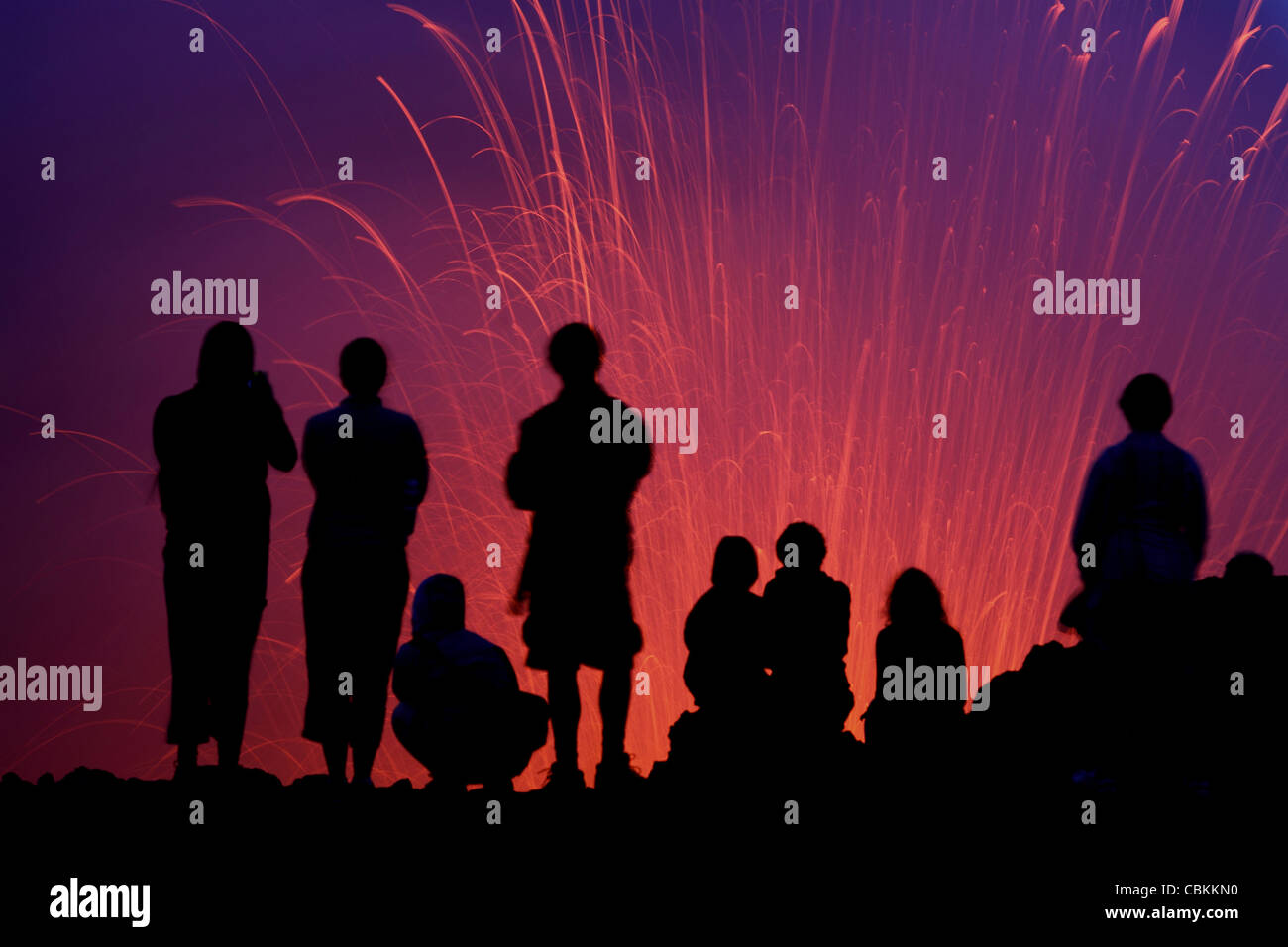 March 6, 2010 - Silhouette of tourists observing the Strombolian eruption of Yasur Volcano, Tanna Island, Vanuatu. - Stock Image