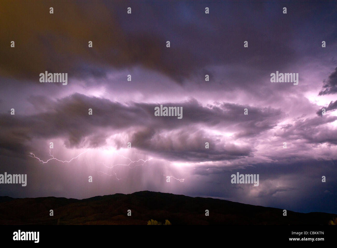 Lightning strikes during a thunderstorm on the first day of summer in Boise, Idaho, USA. Stock Photo