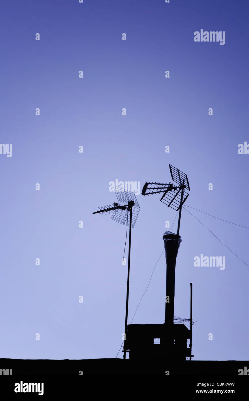 TV aerials against sky at dusk - Stock Image