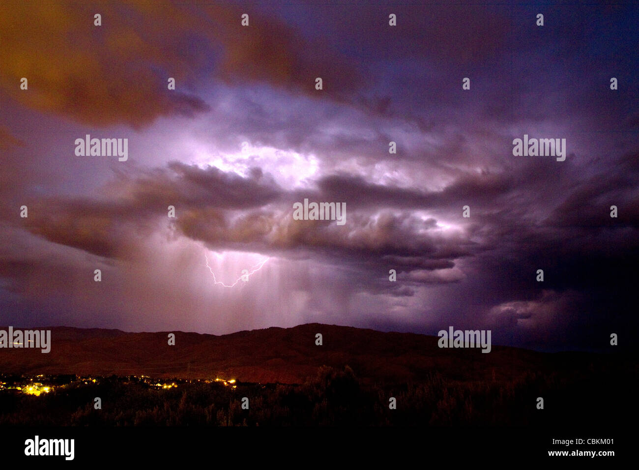 Lightning strikes during a thunderstorm on the first day of summer in Boise, Idaho, USA. - Stock Image