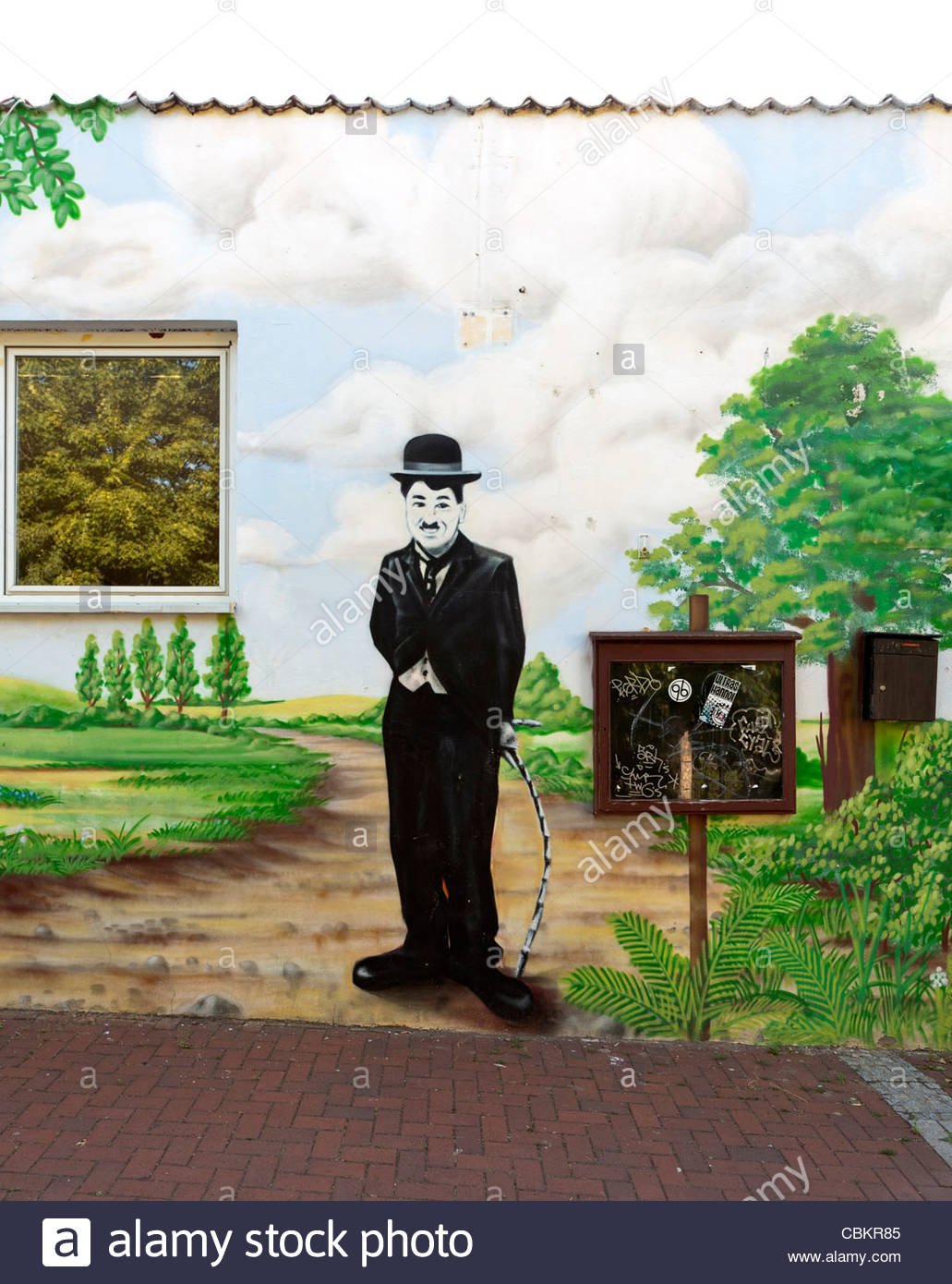 Mural on the side of a building of Charlie Chaplin as the Tramp, Hildesheim, Lower Saxony, Germany - Stock Image
