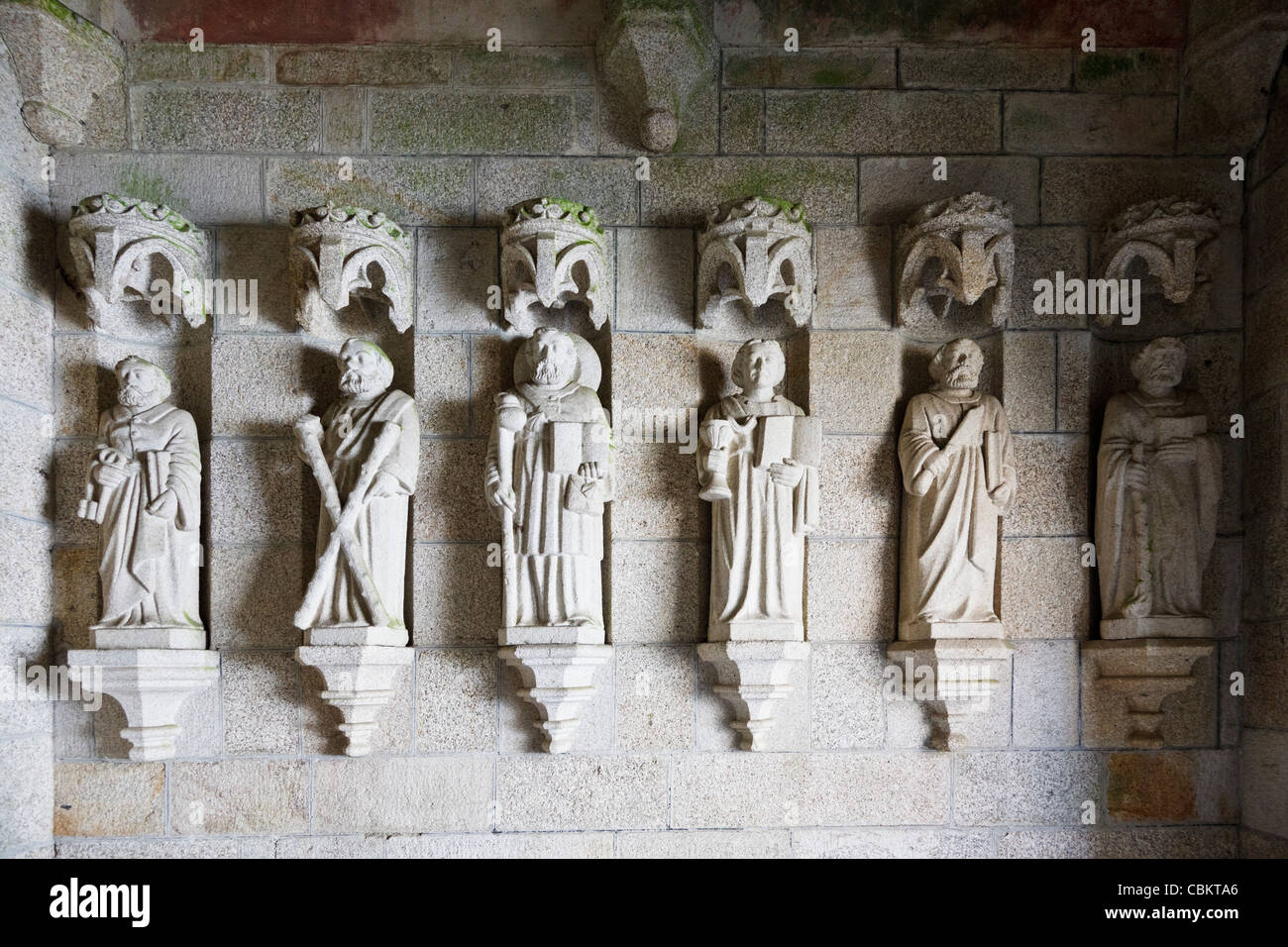 Statues of Saints in a church doorway, France - Stock Image