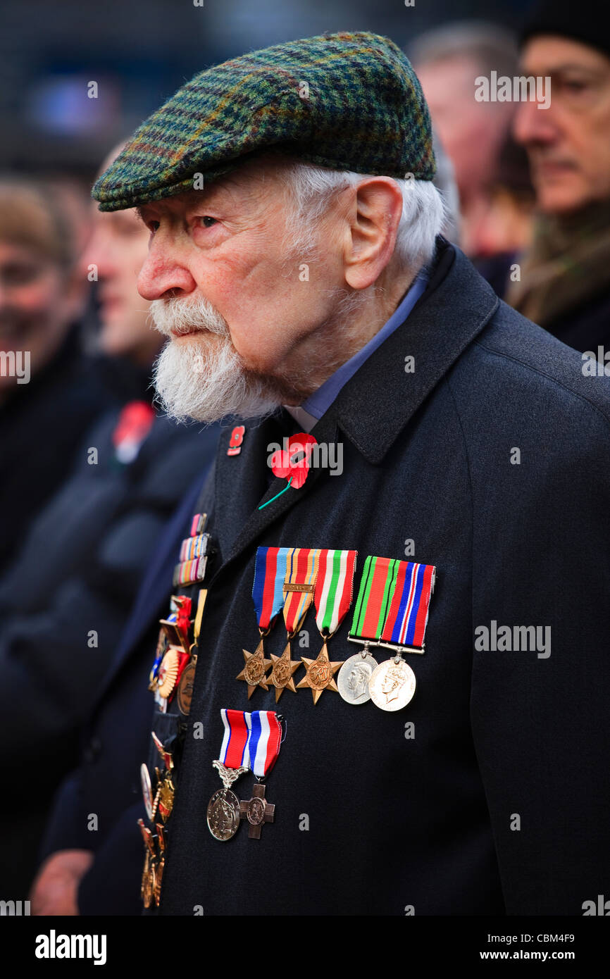 Veteran soldier wearing his war medals, attending a Remembrance ceremony at the Cenotaph in George Square, Glasgow, - Stock Image