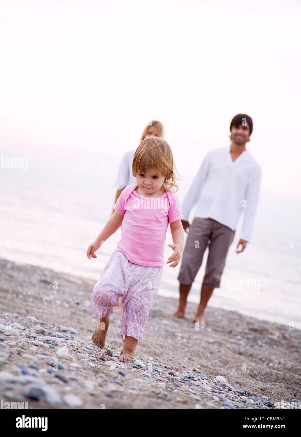 young family on the beach Stock Photo