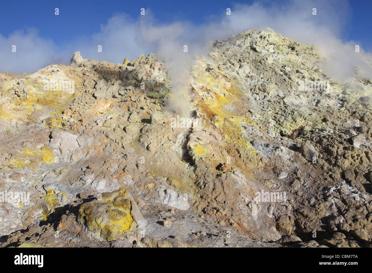 June 25, 2011 - Fumaroles with sulphur deposits. Flank of Bocca Nuova crater, Mount Etna volcano, Sicily, Italy. - Stock Image