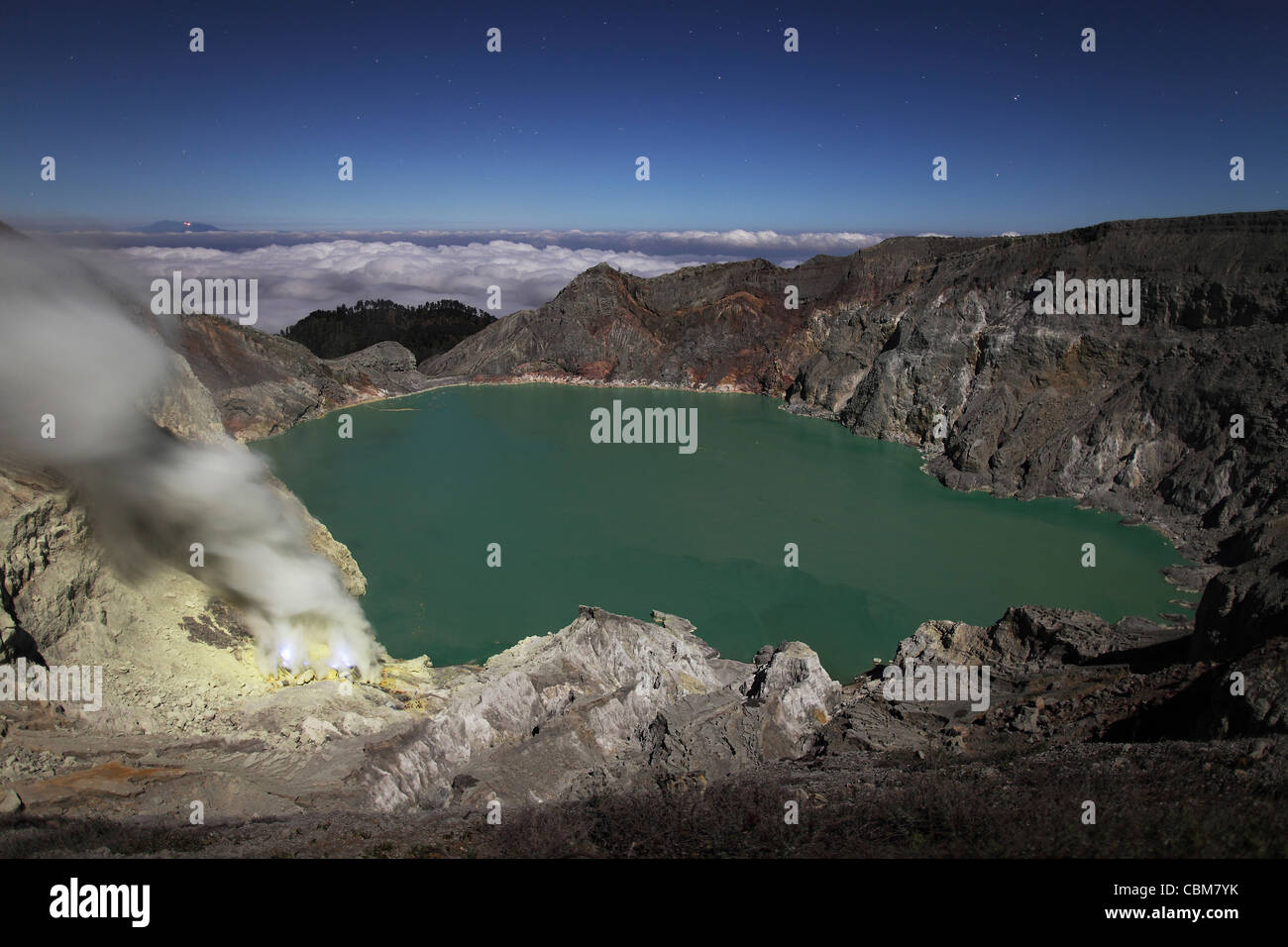 Crater of Kawah Ijen volcano containing highly acidic crater lake and solfatara with blue sulphur flames, Java, - Stock Image