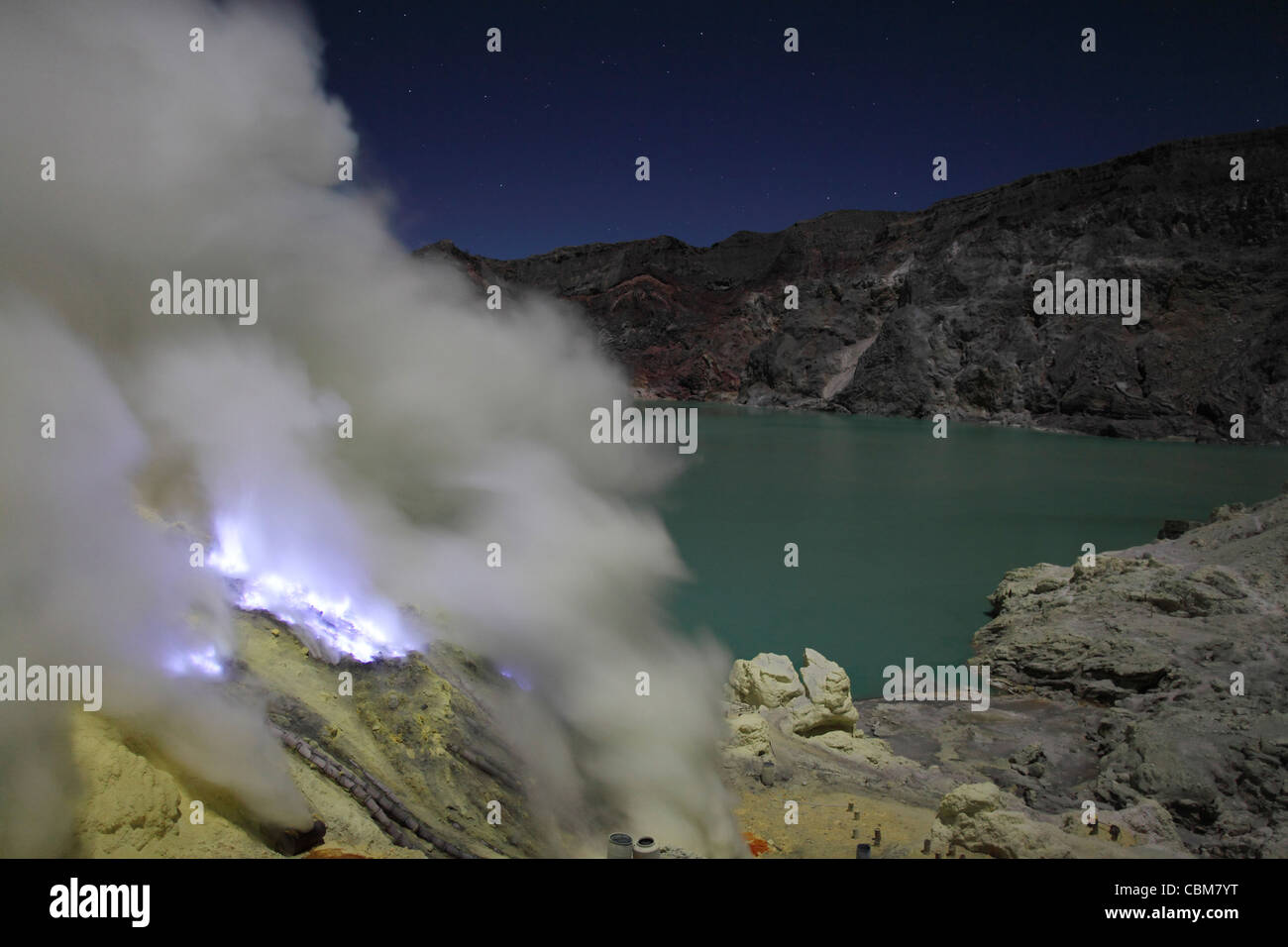 Crater of Kawah Ijen volcano containing highly acidic crater lake and solfatara with burning blue sulphur flames, - Stock Image