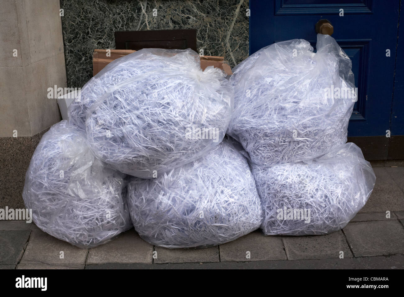 bags of shredded paper documents sitting outside an office belfast northern ireland uk united kingdom - Stock Image