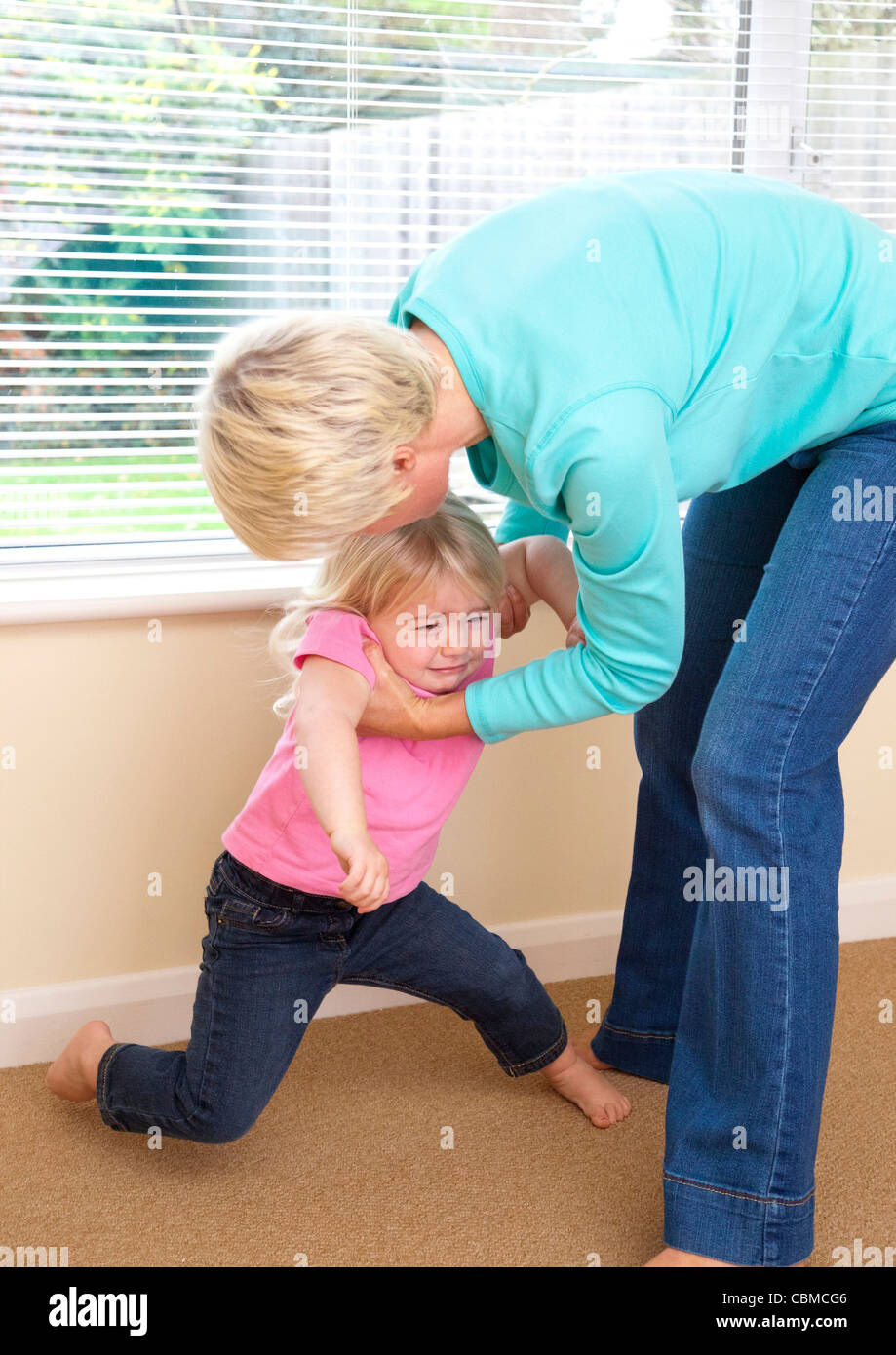 mother with child badly behaving - Stock Image