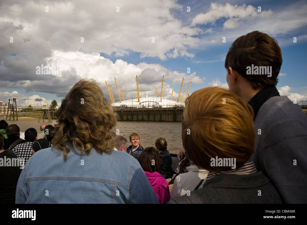 Sightseers on a Thames River boat guided tour, London, UK - Stock Image