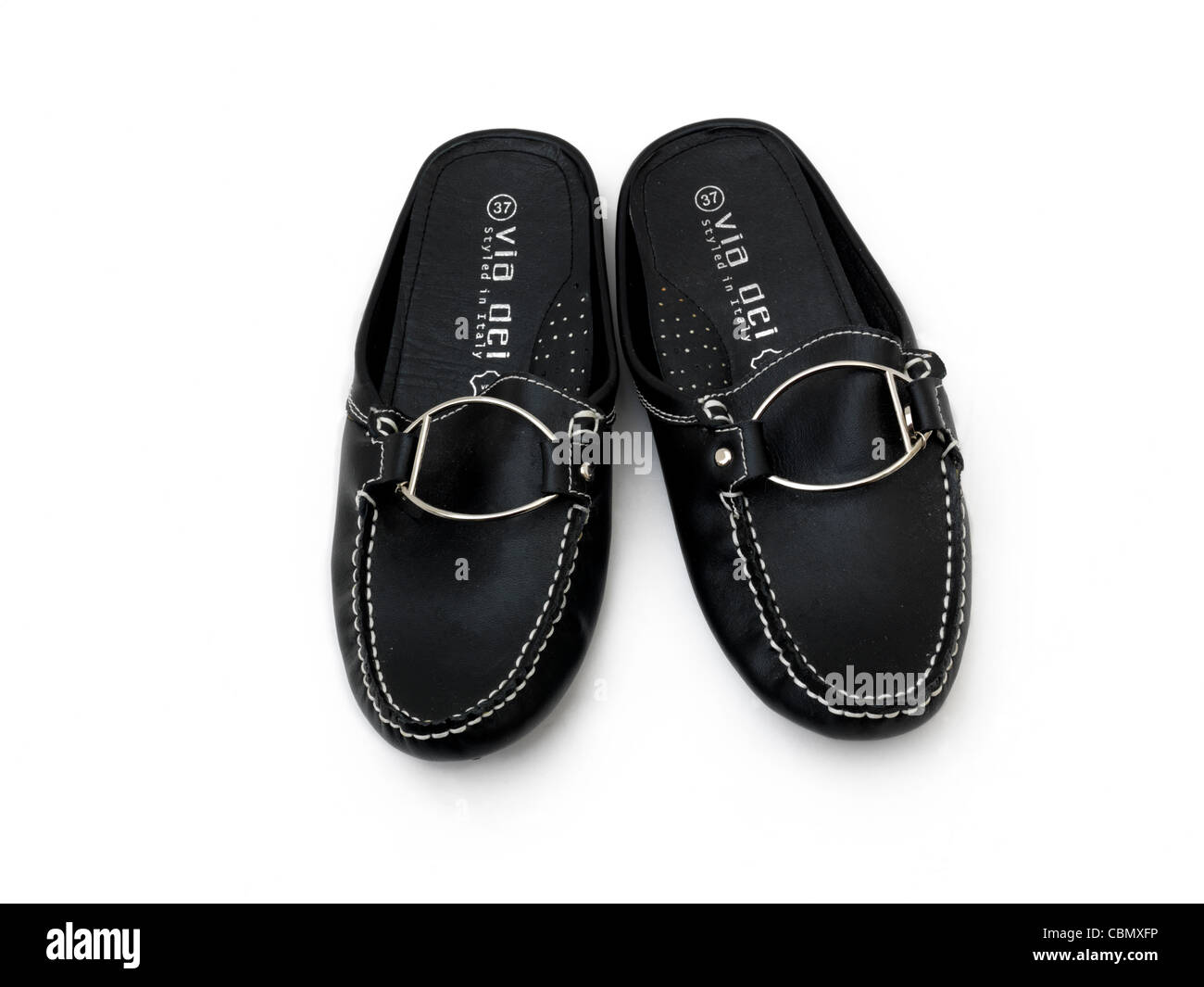 ac181679cb7 A Pair Of Black Leather Slip On Shoes With Silver Buckle - Stock Image