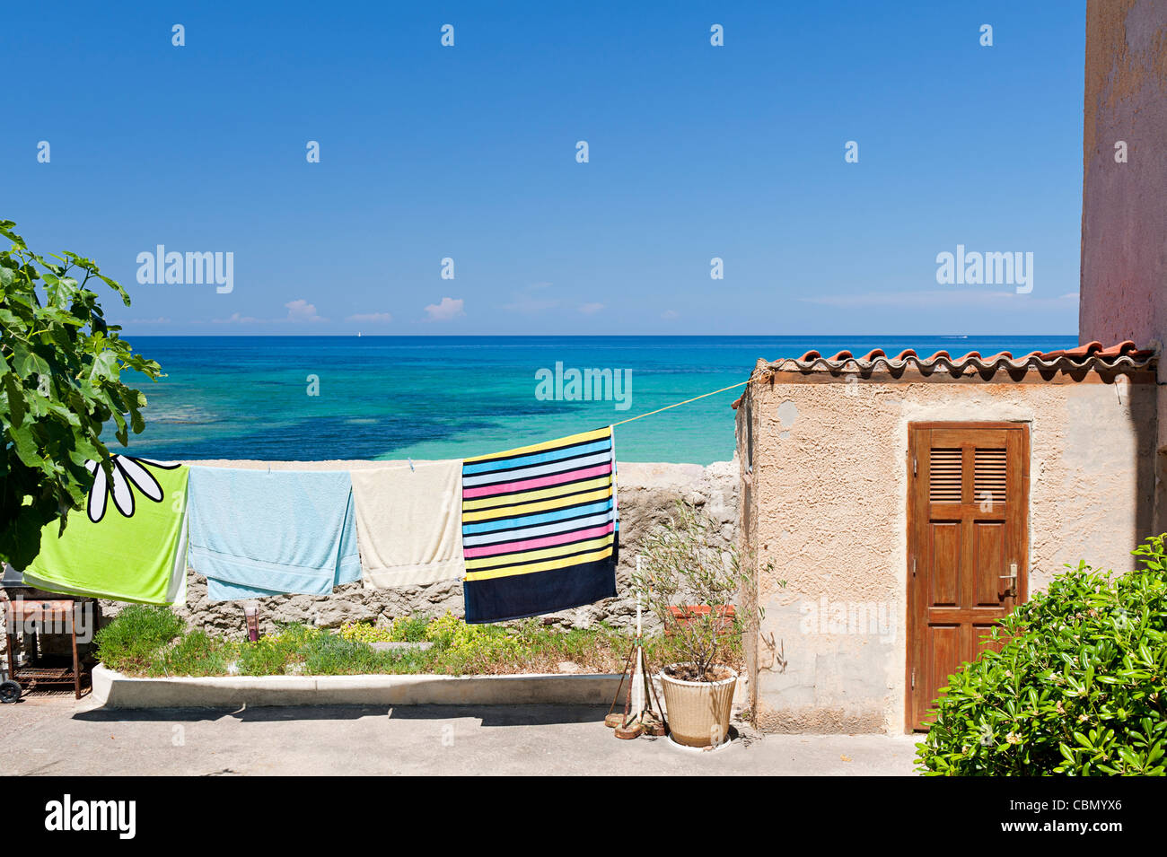 Towels on clothesline by the sea - Stock Image