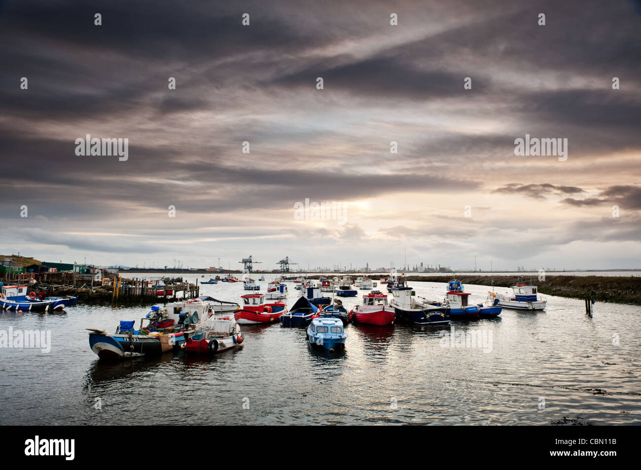 Teesside industry at South Gare & Paddy's Hole, with fisherman's boats - Stock Image