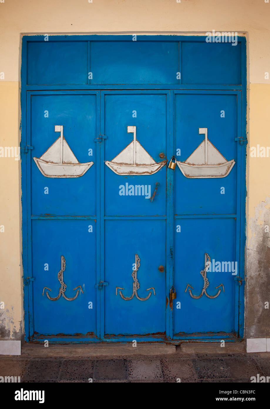 White Boats Painted On A Blue Door In Berbera Somaliland - Stock Image