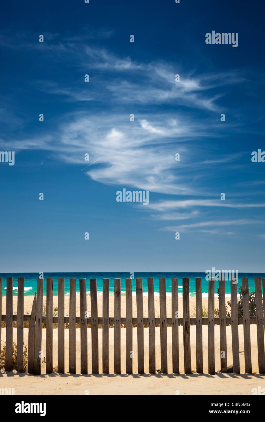 sky with clouds on the beach with a wooden fence - Stock Image